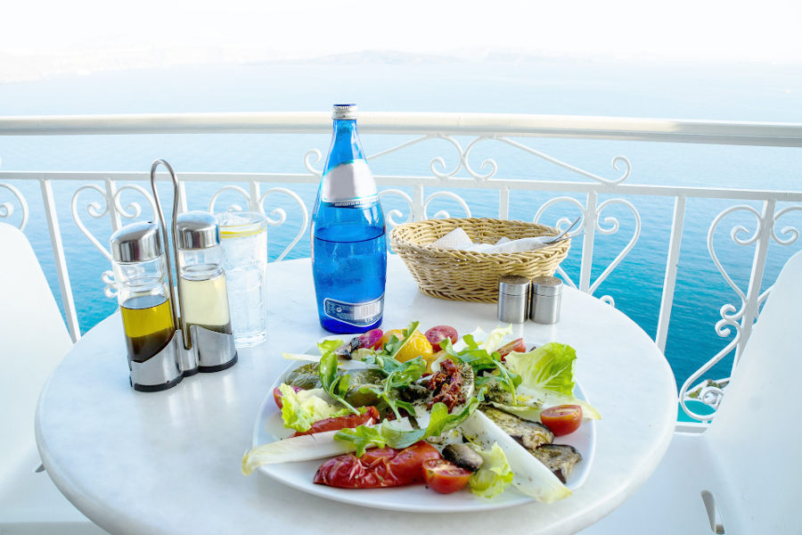 a delicious meal on an ocean facing terrace- create a life you don't need a vacation from